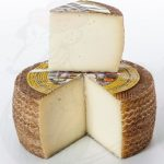 manchego-cheese-wheel-with-wedge-cut-out